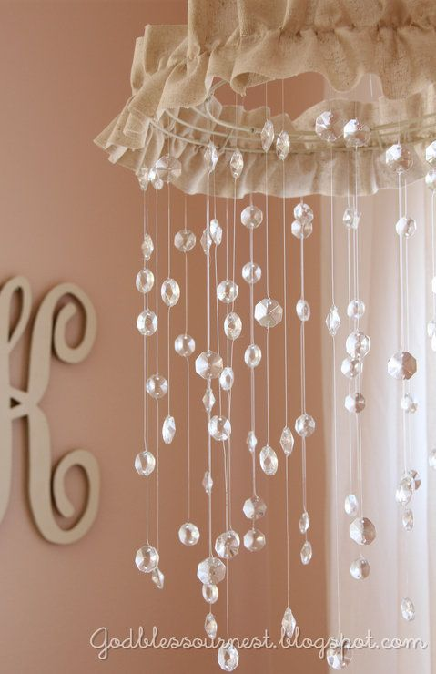 ok so i know this is a baby mobile from a pregnancy website...but it's still a cool idea for like a lamp hanging or something! ...only with pearls instead of the stones. haha