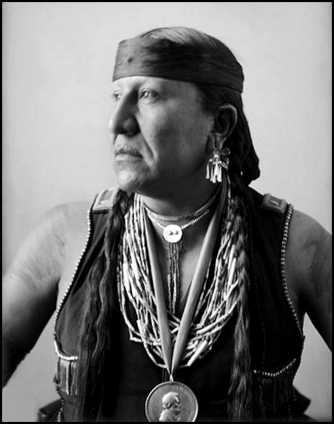 """Pawnee man, Eagle Chief, 1900, wearing an Abraham Lincoln peace medal. - The Pawnee lived along outlying tributaries of the Missouri River: around Nebraska and northern Kansas. 1800's: the Pawnee were 10,000 strong and were one of the largest, powerful tribes on the Great Plains. 1859: Their numbers declined to about 1,400; by 1874 they were up to 2,000. Subject to encroachment by Lakota and Whites, most accepted life on a reservation in Indian Territory. Their antonym is """"men of men""""."""