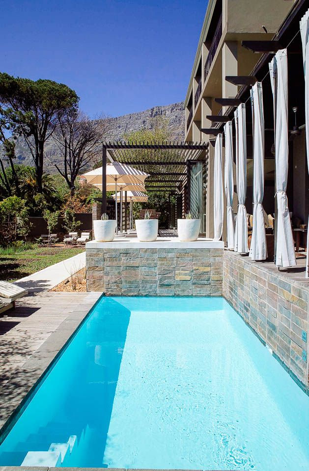 Kensington Place - Cape Town's original boutique retreat. Kensington Place is focused around the glistening solar-heated pool with spectacular views of Table Mountain where you can tune out with a good book and let the world go by.
