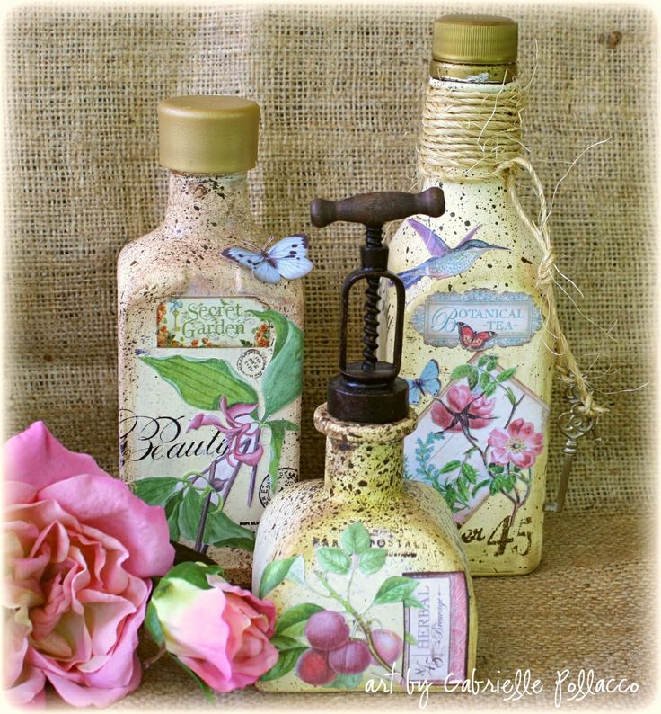 Vintage Bottles made from empty liquor bottles and Graphic45 'Botanical Tea' papers  and G45 metal accents & stamps.  VIDEO TUTORIAL by Gabrielle Pollacco can be found here http://gabriellepollacco.blogspot.ca/2014/07/guest-designer-for-graphic-45-plusvideo.html