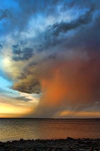 The sunset turns a rainstorm over Lake Eufaula in eastern Oklahoma into an awesome sight.