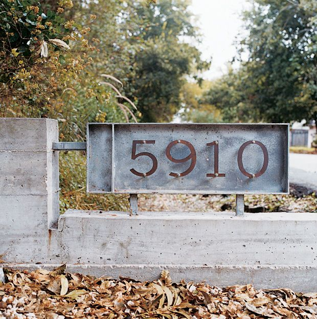 Architectural pioneers Mark Schatz and Anne Eamonbuilt their own 700-square-foot house with a curved roof in Houston, Texas. The pairbought a small sheet of copper, cut out their house numbers, mixed and poured some concrete, and voilá—their own groovy house numbers for $125. Photo by Misty Keasler.  Photo by Misty Keasler.   This originally appeared in Small Amidst Sprawl.