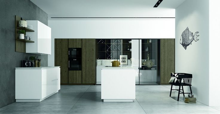 MATERIA by Doimo Cucine Neatness of the profiles, of the pure white calacatta marble and of white lacquer warmed up by scalfito ossido oak.note the elegant storage area enriched by a wine cellar....many more solutions at TOGNIN ARREDAMENTI www.togninarredamenti.eu www.doimocucine.it