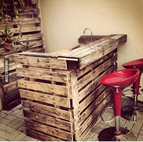 bar with running water out of shipping pallets