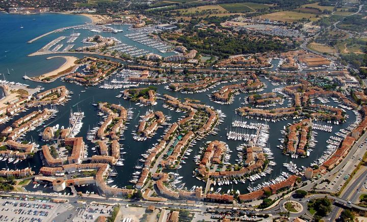 """Port Grimaud, France  This place is also called """"Provencal Venice"""" with all those canals. This is also a home to some of the wealthiest yacht enthusiastic in the world. St. Tropez is very near this place."""