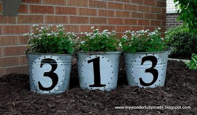 Cute idea for outside your home! house number. flower pots.