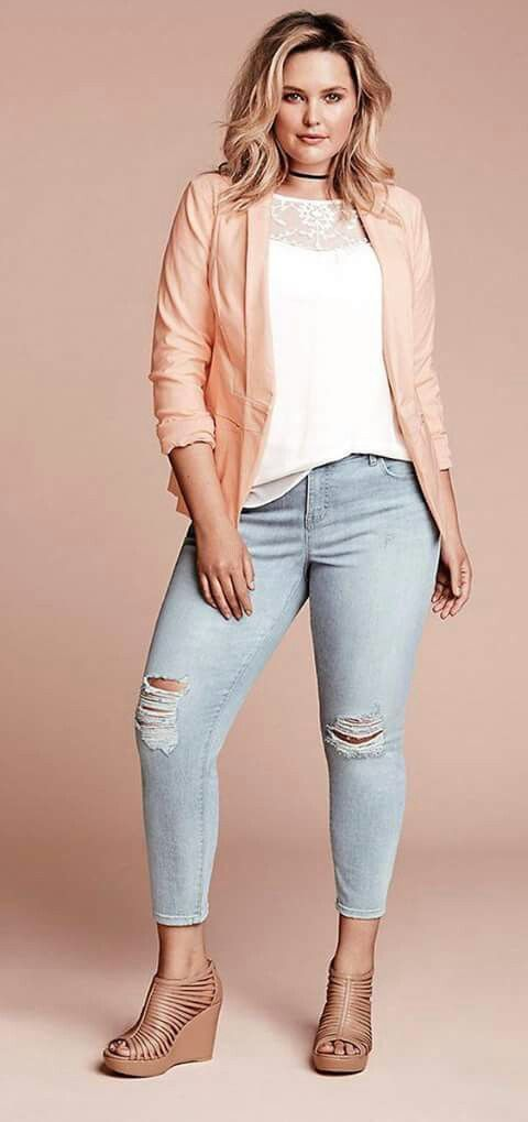 Pink jacket, white top, light wash jeans, tan booties