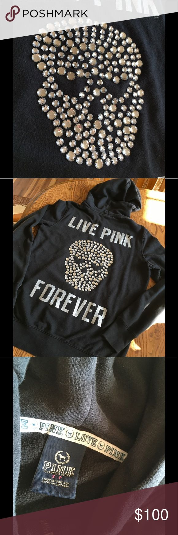 Pink Special Edition Skull hoodie bling small Black zip up hoodie with silver dog on front, live pink forever on back, clear large rhinestones in the shape of a skull on back.  No holes, or discoloration, slight piling from wear, not noticeable. Worn only a few times. EUC PINK Victoria's Secret Tops Sweatshirts & Hoodies