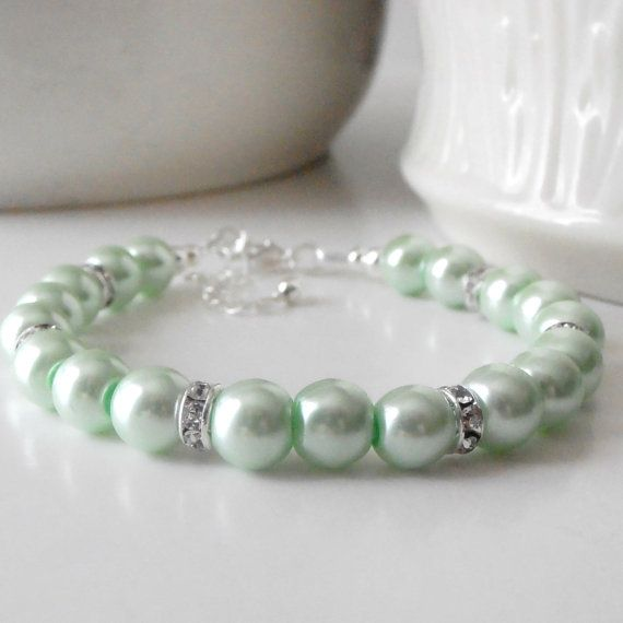 Mint Pearl Bridesmaids Bracelets as their gift--make something similar in the colors you choose and / or pearl...box and give before wedding for them to wear during ceremony!