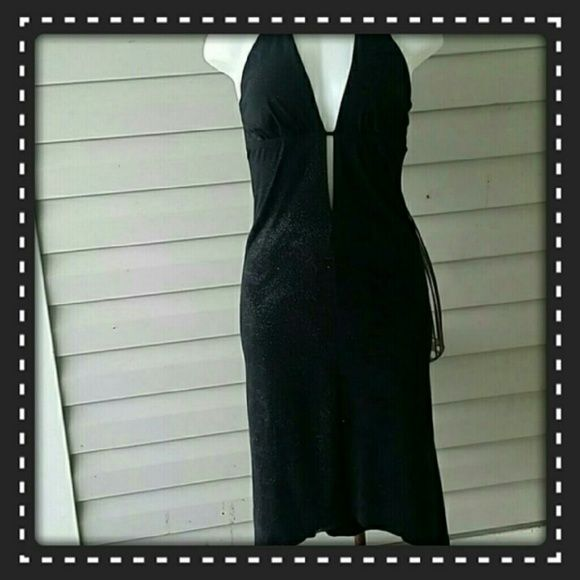 ????? Elegant  Party Dress V neck black  dress ?? Light weight  deep plunge  neckline  . Classy.  Strap goes around  the neck. The sparkles all over  the dress are flat, but viewable.  Stunning Forever 21 Dresses