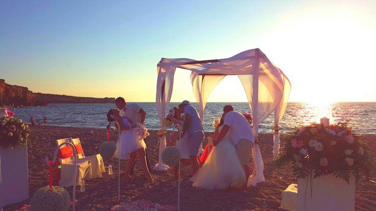 Triple beach wedding.