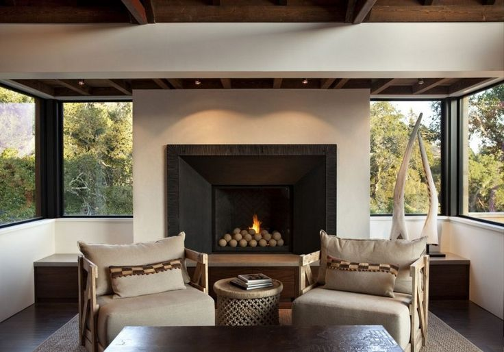 The Contemporary Hillside House-Love the fireplace, windows, furniture, just beautiful