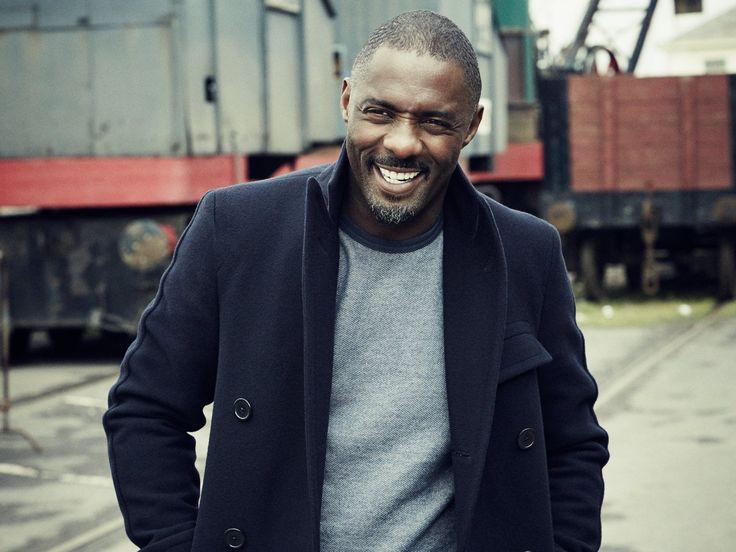 Idris Elba Wearing: Navy Wool Coat + Charcoal Grey Crew-Neck Sweater + Navy Denim Jeans, All by Polo Ralph Lauren | via Esquire