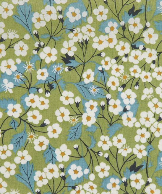 Mitsi C Tana Lawn from the Liberty Art Fabrics collection.         This design was re-created from a design in the Liberty Archive by the Liberty Fabric design studio for autumn 2008 season. It plays on Liberty's history with its Japanese style cherry blossom. The original was designed a member of Liberty's studio in the 1950s. It was then recoloured to go into the 2011 Classic Tana Lawn Collection.