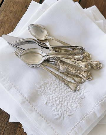 sterling and silver plate cleaning: Sprinkle half to one cup baking soda over silverware you have placed in an aluminum pan. Keep the pan in the sink. Pour over enough boiling water to cover the utensils. When the tarnish disappears, remove the silverware and buff with a soft cotton cloth. (info relayed from a friend to me)