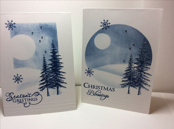 Inked and stamped Christmas cards. A6 white card, stormy sky distress ink for the background, denim Adirondack for the trees, words and snowflakes, diamond sparkles glitter and gems.
