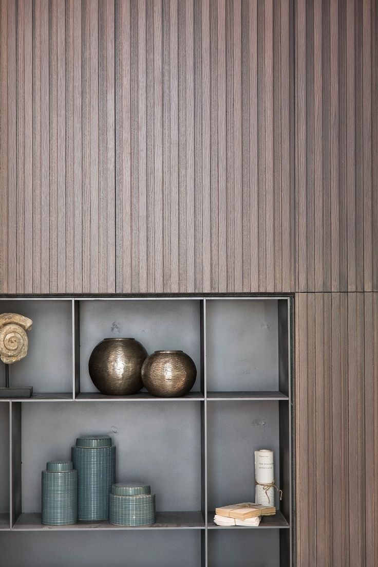 Bibbed wood paneling and inset metal shelves