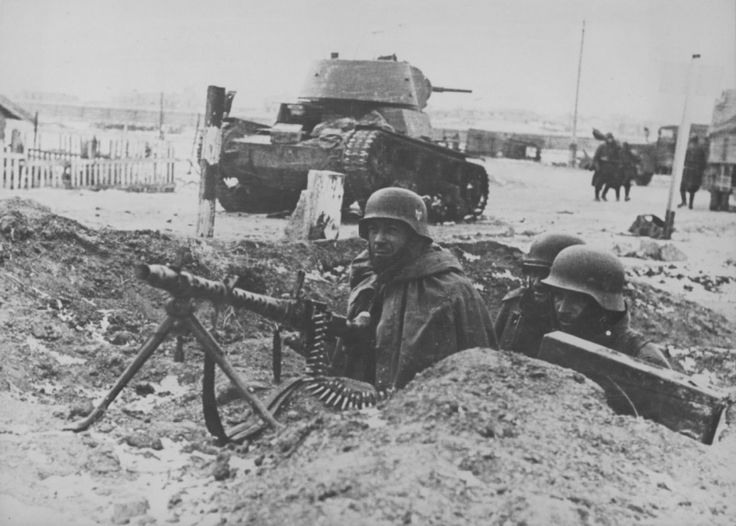 German machine-gun in a trench is monitoring the situation. In the background image thrown soviet light tank T-26.