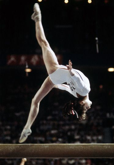 Romanian gymnast Nadia Comăneci at the 1976 Olympic Games, the first perfect 10 in gymnastics  http://www.pinterest.com/crevette46/nadia-comaneci/