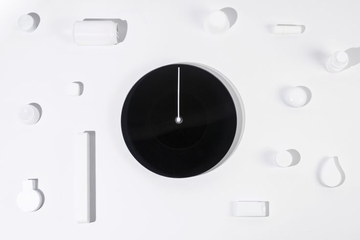 DUSK (Polaroid Clock) - The Dusk's #minimalistic #design hides a sophisticated mechanism that allows the whole #clock face to change its shade from transparent to opaque, representing the colour of the sky. Throughout the day the Dusk will loop from dark to transparent and dark again as the sun rises, reaches its highest point and sets again.