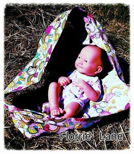 Handmade by Florrie Lane This delightful doll carrier will keep the kids entertained.