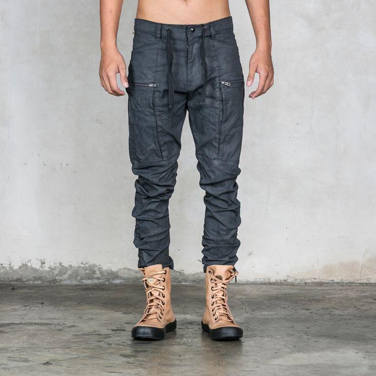 Crater black cotton poplin men's cargo pants. Zippered thigh pocketss, custom Heathen button and a drawstring tops the zip fly. Heathen Clothing.