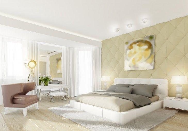 Wystrój wnętrza sypialni z białym tapicerowanym łóżkiem. Pomieszczenie zdobią stylowe meble i dodatki - designerskie lampy i obraz.