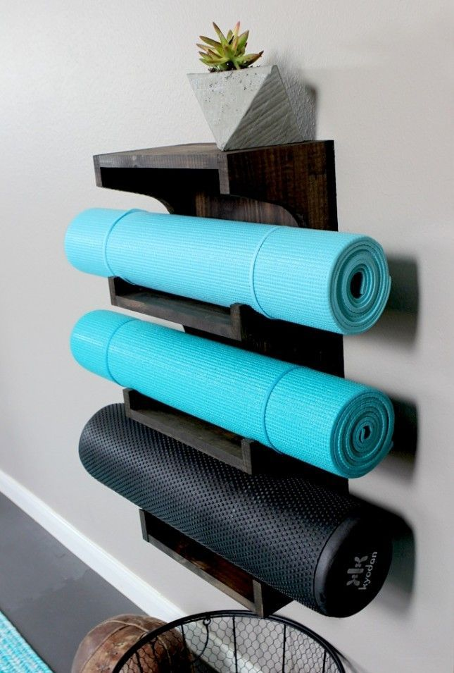 Keep your yoga mats on display with this DIY rack. Home Gym Ideas. The easy way to buy or sell your home and maximize your ROI - http://www.LystHouse.com