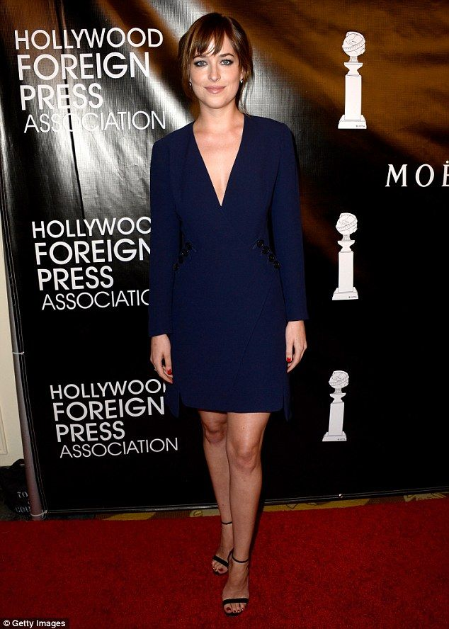 Style star: Dakota Johnson maintained her glamour girl reputation at the HFPA Annual Grants Banquet on Thursday