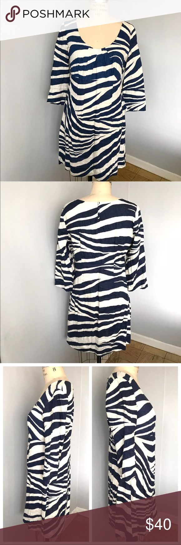 "Boden Linen Zebra Print Dress Boden Women's Linen Navy Cream Zebra Print 3/4 Sleeve Dress  Good condition with no damage or stains.  DETAILS: Buttons in the back from neck (see photo 4)  MEASUREMENTS: 38"" length 37"" bust 33"" waist 41"" hip  ***Please feel free to ask any questions***  💚Thank you for your interest!💚  (LJ0001:1223) Boden Dresses"