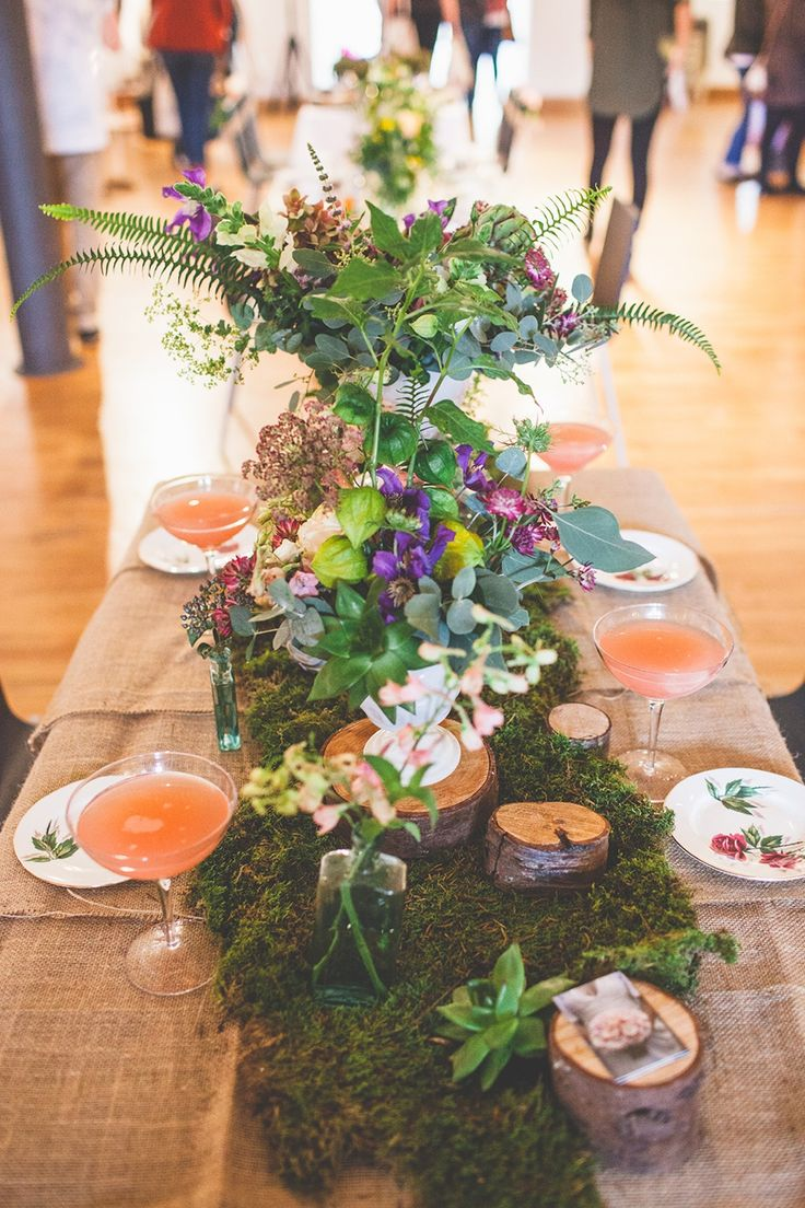 Mossy, rustic wedding reception table centre display.  From 'The Glasgow Wedding Collective, Sunday 4th May 2014, The Lighthouse, Glasgow' photographed by http://christophercurrie.co.uk/