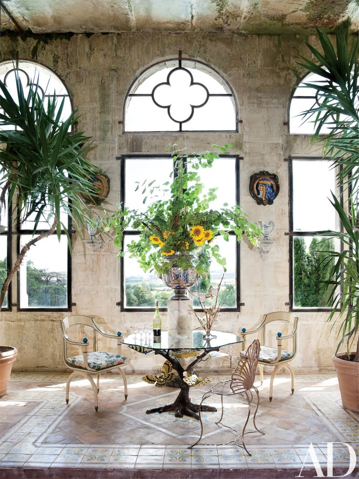 Adjacent to the grand salon is a sunroom with quatrefoil windows; Joy created the sprightly furnishings