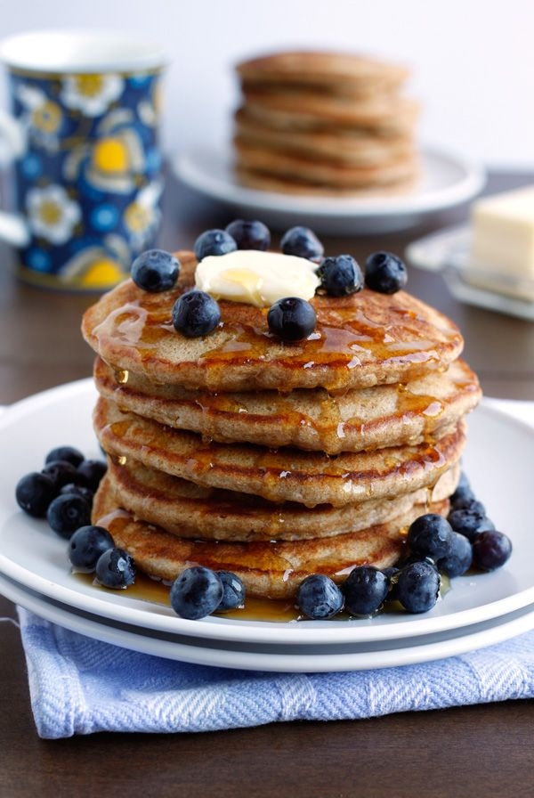 Fluffy Whole Wheat Pancakes- There's no better way to start a lazy weekend morning than with a stack of hot and fluffy pancakes. My favorite pancake recipe of all time, you won't believe how perfectly fluffy they are.
