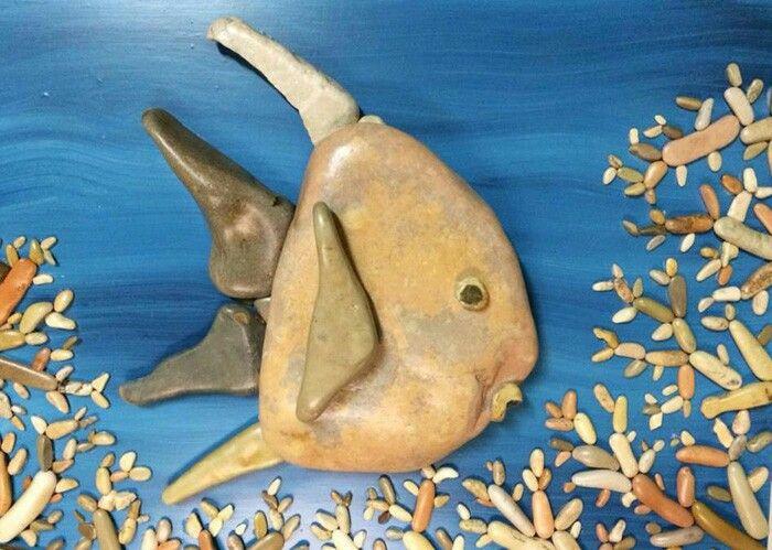 Fish undersea a stone art