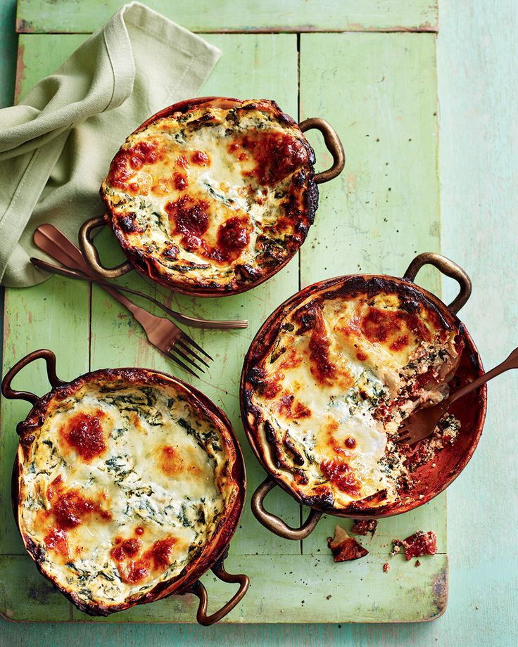 We've put a twist on the classic lasagne with a creamy spinach and ricotta filling. This vegetarian version is finished off with slices of mozzarella, creating an alluring, cheesy topping.