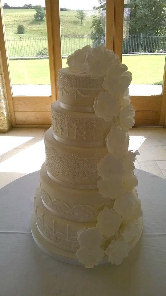 Pretty on the outside, indulgent on the inside! Vanilla sponge with strawberry jam and chocolate truffle torte!  #cake #weddingcake #vanilla #sponge #strawberry #jam #truffle #torte #buttercream