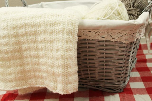 Witte wollen deken haken voor je baby