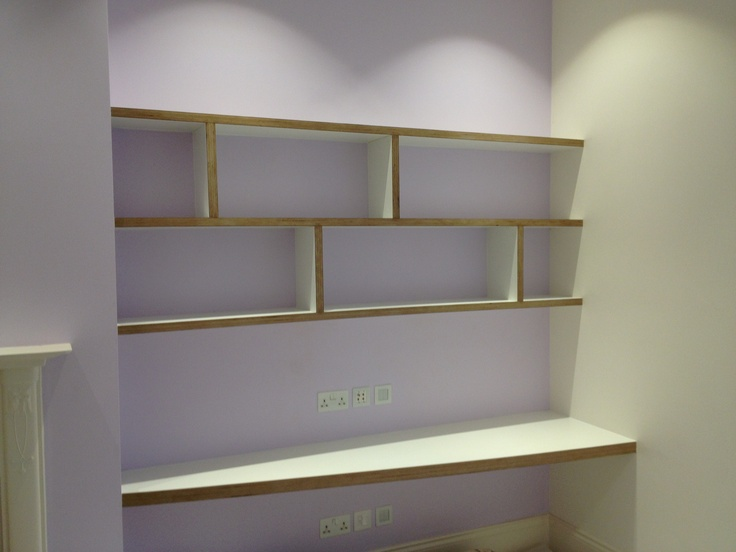 This shelving and desk feature birch multi layer ply as is edging detail, with egger platinum white surface. Alcove shelving. By Fine Balance Carpentry.