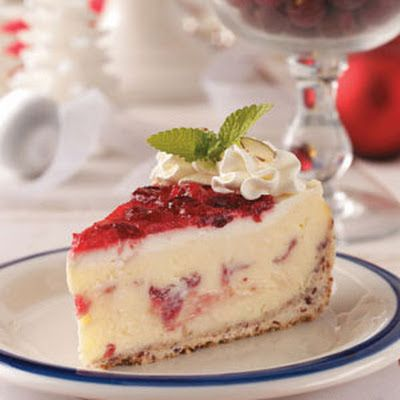Cranberry Celebration Cheesecake ~  ½C dried cranberries /  2C cake flour /  ½cup ground almonds /  ¼cup confectioners' sugar /  ½cup cold butter, cubed FILLING: ¾C plus 1-½ cups sugar, divided 2T cornstarch /  ¼cup cranberry juice /  2cups fresh or frozen cranberries /  4 (8 ounces each) cream cheese, softened /  1t vanilla extract /  4eggs, lightly beaten TOPPING:  2cups (16 ounces) sour cream ¼C sugar 2t vanilla extract 1C heavy whipping cream ¼C ground almonds