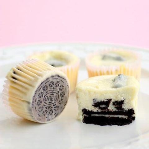 OREO MINI CHEESECAKES 42 Oreos, 30 whole & 12 crushed  2lbs cr cheese 1c sugar  1t vanilla 4lg eggs 1c sour cream  pinch salt 1. 275° oven. Line muffin tins & Place 1 whole cookie in ea.  2.Beat cr cheese at med. + sugar. Beat in vanilla.  3.+ eggs. Beat in sour cream & salt. Stir in chopped cookies by hand.  4. Fill each tin almost to the top. Bake, rotating pan halfway through, until filling is set, about 22 minutes. Transfer to wire racks to cool completely. Refrigerate 4 hrs