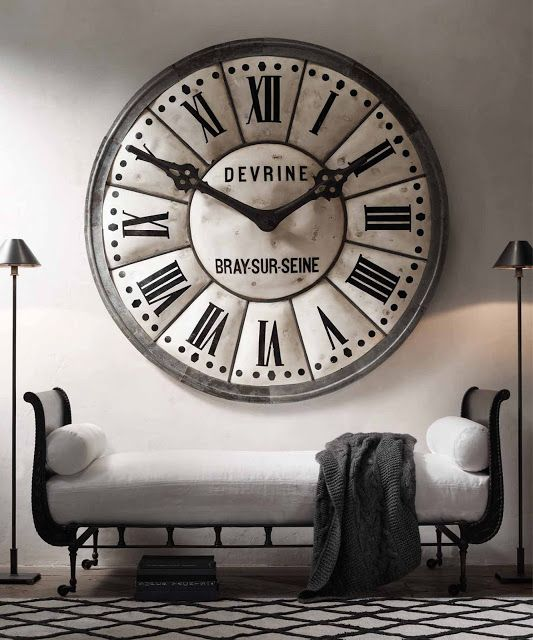 love the idea of an oversized wall clock like this one from rh would fit