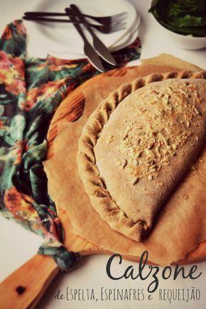 Calzone de Espelta, Espinafres e Requeijão {para a massa}   220 gr. de farinha de espelta integral   1 c. (chá) de fermento seco   1/2 c. (chá) de sal   2 c. (sopa) de azeite   1 ovo   60 ml de água quente  {recheio}   40 gr. de sementes de girassol + q.b. para decorar   1 chalota   2 dentes de alho   2 c. sopa de azeite   250 gr. de espinafres    sal q.b.   pimenta q.b.   noz moscada q.b.   240 gr. de requeijão de vaca    100 gr. de queijo curado   folhas de hortelã-menta