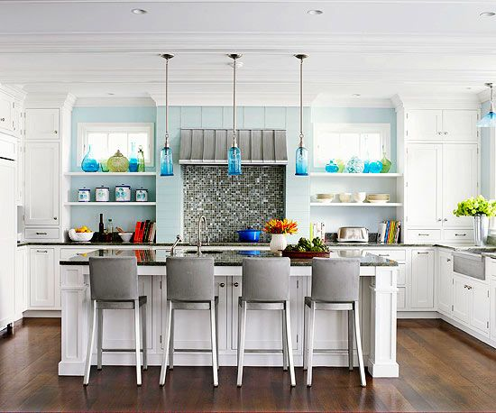 Glass pendant lights are a great way to carry the colors from your backsplash into the rest of your kitchen space.
