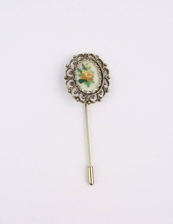 Needlepoint hat or lapel pin in my Etsy shop https://www.etsy.com/ca/listing/588000557/80s-needlepoint-roses-pin-filigree