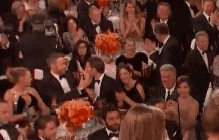 While Ryan Gosling was winning, Ryan Reynolds and Andrew Garfield were kissing! Reason #49 I'm happy there's a lot of wine at the Golden Globes.