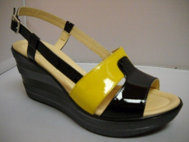 Donna Soft from Italy.  Patent slingback with 8cm layered wedge.  Available in Black/Yellow and Black/marble.    Sizes range 36-41.