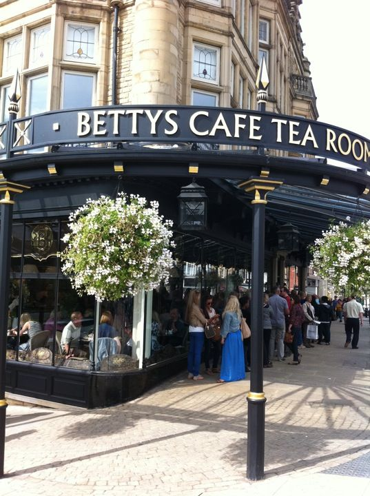 Traditional afternoon tea and sandwiches are served at Betty's Tea Rooms in Harrogate, North Yorkshire. Beware, there's always a queue...