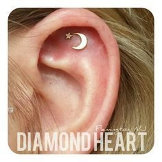 diamondheartpiercing: Two ear piercings placed specifically for this combination of jewelry in solid rose gold ~ a moon and star from @anatometalinc ~ pierced with 14g labret backings
