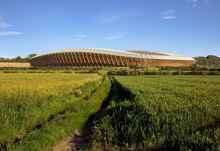 """The famed Zaha Hadid Architects has done it again, announcing its selection as the designer of what will be the most unique soccer (football) stadium in the world.  The Forest Green Rovers stadium, located in England, is part of the new 100-acre Eco Park, which will also include a nature reserve, a transportation hub and a canal restoration project. """"Our new stadium will have the lowest carbon content of any stadium in the world. This really will be the greenest football stadium in the…"""