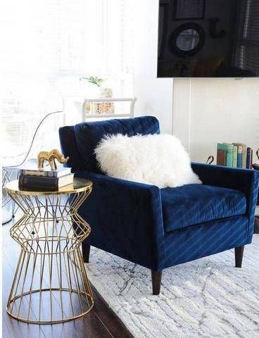 An oversized rich navy chair is a great lounging piece for your living room.